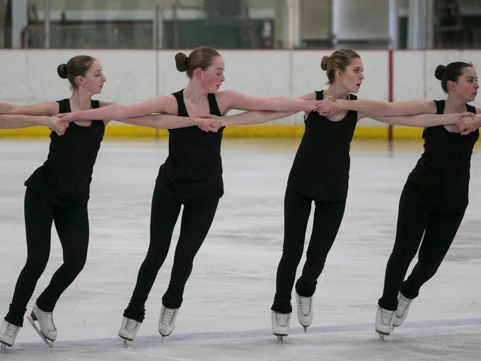Members of the Shadows Synchronized Skating Team from