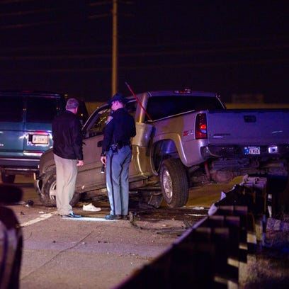 Indiana State Police investigate a scene on I-70 where