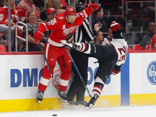 Red Wings defenseman Niklas Kronwall checks Coyotes