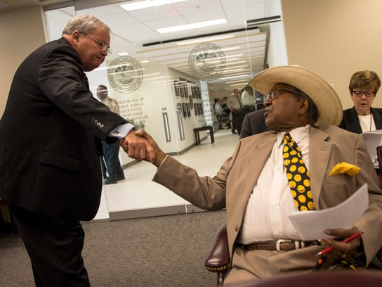 Shelby County Sheriff Bill Oldham (left) greets former county commissioner Sidney Chism.
