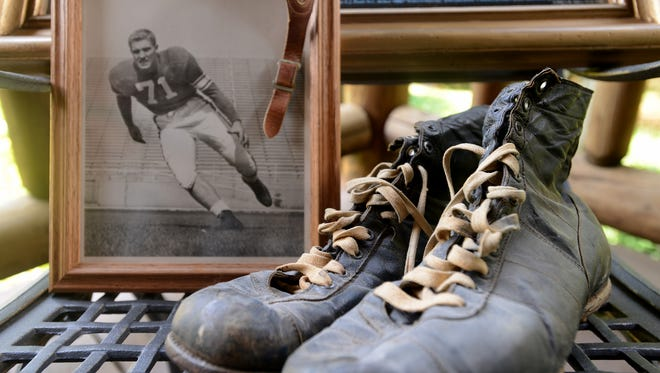 Former PSU football player Jim Harding, who now lives in Huntingdon, TN, still has his old shoes and chin strap he used during his time in school.