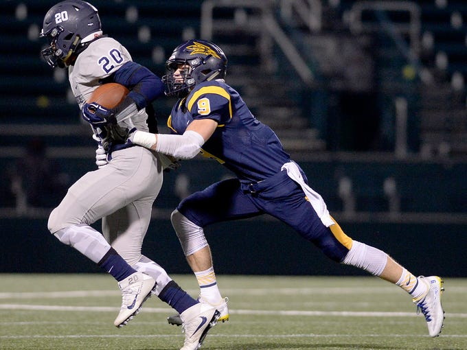 Victor's Andrew Russell, right, chases down Pittsford's