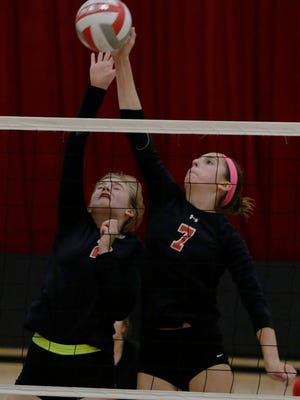 Lourdes Academy's Rachel Aasby and Lauren Hamill go up for a hit against Central Wisconsin Christian. Lourdes Academy lost to the Crusaders 3-1.