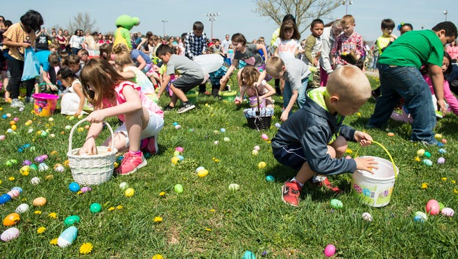 Kids in the 7 to 8 age group scramble to collect Easter eggs during the Hanover community egg hunt at Moul Field on Saturday, April 15, 2017.