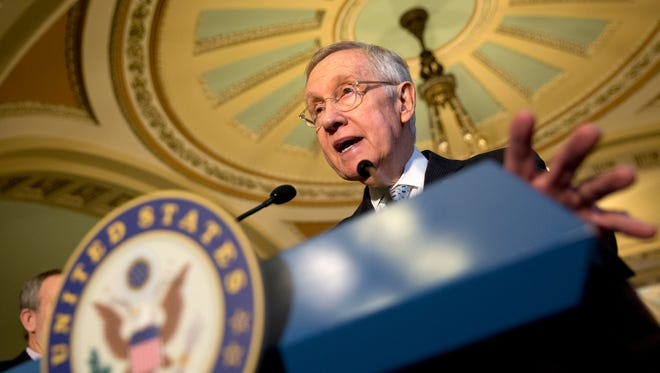 Senate Minority Leader Harry Reid of Nev., accompanied by the Senate Democratic leadership, speaks during a news conference on Capitol Hill in Washington, Tuesday, Nov. 17, 2015.