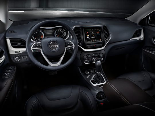 The Cherokee Trailhawk's interior is a sportier scaled-down version of the Grand Cherokee's.