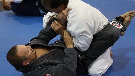 Joshua Mooney and Mike Ellefson (on bottom) are shown demonstrating Brazilian Jiu-Jitsu.
