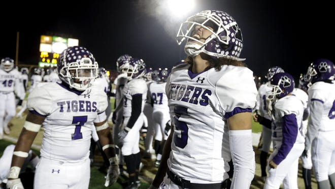 Garner Wallace celebrates in the waning seconds of Pickerington Central's  28-21 victory over Mentor in a Division I state semifinal last season. Wallace is the likely replacement at quarterback for all-Ohio selection Demeatric Crenshaw, who graduated.