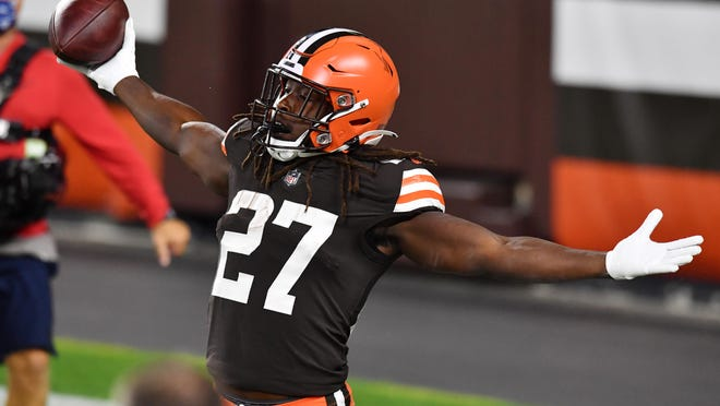 Sep 17, 2020; Cleveland, Ohio, USA; Cleveland Browns running back Kareem Hunt (27) celebrates after catching a touchdown during the first half against the Cincinnati Bengals at FirstEnergy Stadium. Mandatory Credit: Ken Blaze-USA TODAY Sports