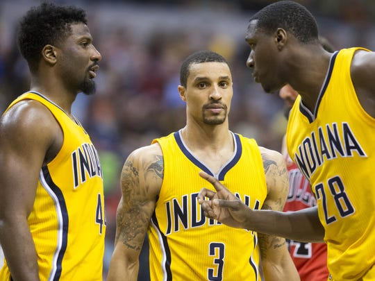 Solomon Hill (left), George Hill and Ian Mahinmi talk strategy during second half Tuesday against Chicago.