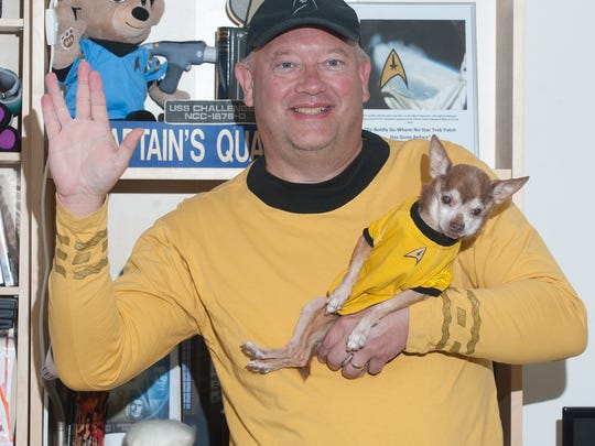 Bob Vosseller, a Star Trek fan, poses with his Chihuahua at his home in Lindenwold. Star Trek is celebrating its 50th year with a large trekker convention in Cherry Hill at the end of the month.