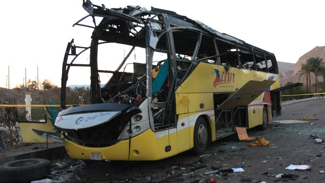 A Egyptian tourist bus that was bombed in a terror attack on Feb. 16 sits at Taba crossing in Sinai near the Israel border. Three South Koreans and the Egyptian driver were killed in the attack. The bomb was under the driver's seat.