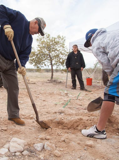 Employees of the Federal Fugitive Recovery Agency, a private company based in Las Vegas, and area residents dig for clues in the disappearance of Jerry and Susan McFalls of Littlefield, Arizona, on Saturday, March 17, 2018.