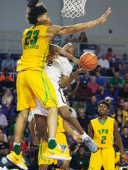 The Patrick School's Nick Richards defends Hudson Catholic's Louis King during play Sunday at the Culligan City of Palms Classic at the Suncoast Credit Union Arena in Fort Myers.
