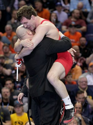 Cornell's Gabe Dean hugs associate head coach Damion Hahn after defeating Lehigh's Nathaniel Brown 6-2 in their 184-pound championship match on March 21, 2015, at the NCAA Division I Wrestling Championships in St. Louis.