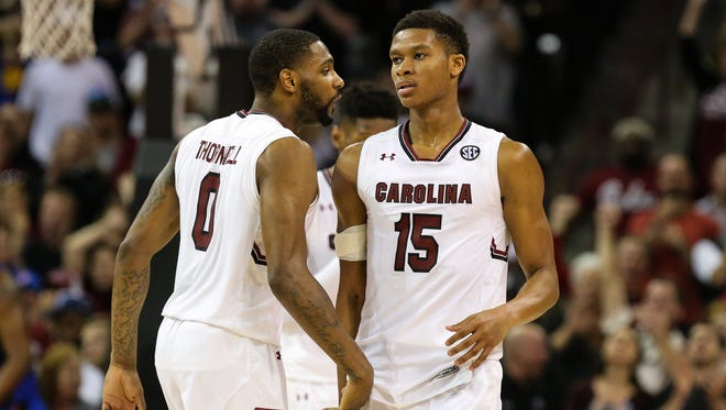 South Carolina Gamecocks guard Sindarius Thornwell (0) congratulates guard PJ Dozier (15) after drawing a foul in the final seconds during the second half at Colonial Life Arena. South Carolina wins 57-53.