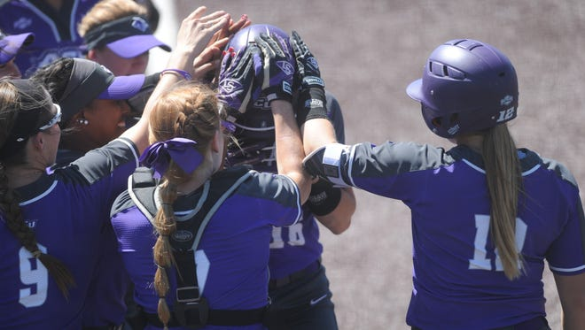 ACU teammates pat Brianna Barnhill on the head after her solo homer gave the Wildcats a 3-2 lead in the sixth inning in the second game of a doubleheader. ACU ended up winning the game 5-4 in 10 innings to split the doubleheader Saturday, April 8, 2017 at Poly Wells Field.
