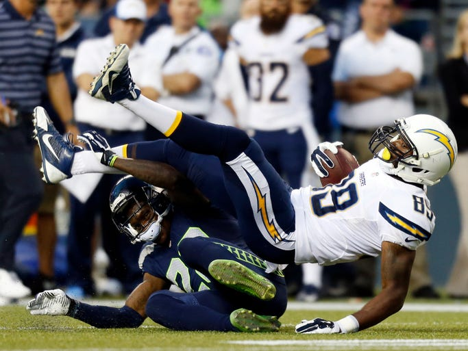 Seattle Seahawks cornerback Phillip Adams, left, tackles San Diego Chargers tight end Ladarius Green (89) in the first half of a preseason NFL football game, Friday, Aug. 15, 2014, in Seattle. (AP Photo/John Froschauer)
