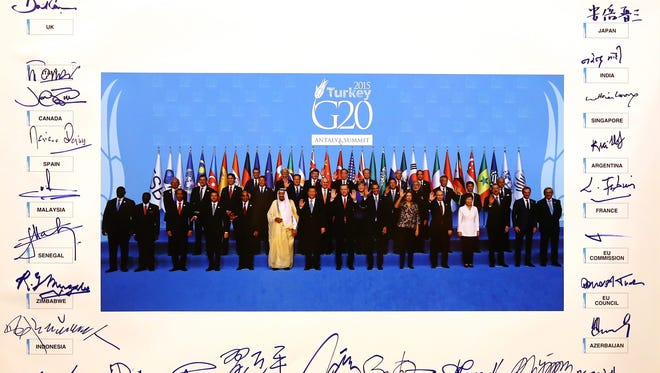 A picture of the Group of 20 summit participants after the leaders signed it in Antalya, Turkey, is released at the summit's end on Nov. 16, 2015.