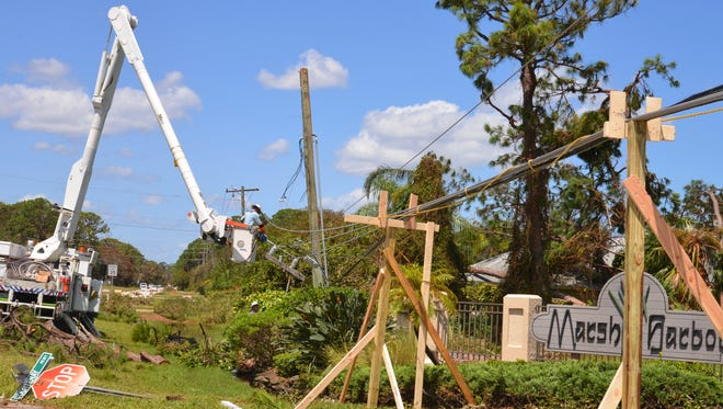 On South Courtenay Parkway at the Marsh Harbor neighborhood, neighbors constructed a stand to lift the power lines that were blocking the entrance to the neighborhood. FPL was repairing the line and transformer Tuesday afternoon.