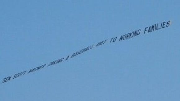 A banner denouncing Scott Wagner was flown over the