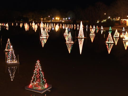 Christmas Trees light up the lake at Smithville Village