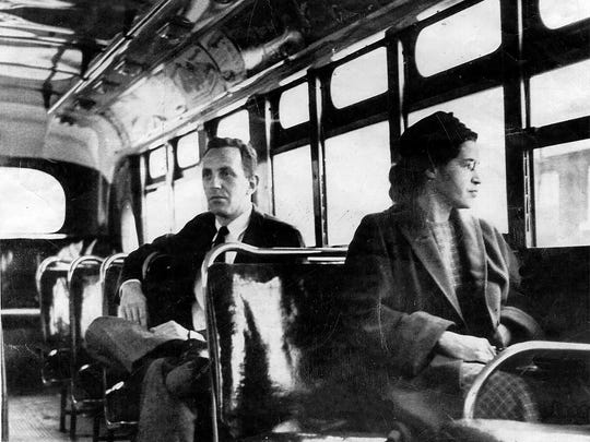 Rosa Parks riding on the Montgomery Area Transit System bus in Montgomery, Ala. Parks refused to give up her seat on a Montgomery bus Dec. 1, 1955, and ignited the boycott that led to a federal court ruling against segregation in public transportation.