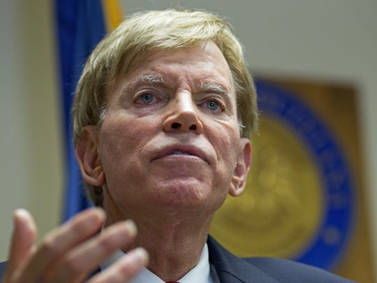 """Former Ku Klux Klan leader David Duke talks to the media at the Louisiana Secretary of State's office in Baton Rouge, La., on Friday, July 22, 2016, after registering to run for the U.S. Senate, saying """"the climate of this country has moved in my direction."""""""