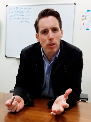 Missouri Attorney General Josh Hawley speaks March 28, 2018, at his campaign office.