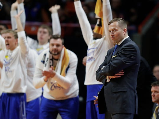 South Dakota State head coach T.J. Otzelberger, front right, watches from the bench during the first half of a first-round game against Ohio State in the NCAA college basketball tournament, Thursday, March 15, 2018, in Boise, Idaho. (AP Photo/Ted S. Warren)