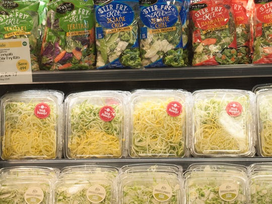 Stir fry veggies and salads are shown at the Whole Foods  in Cherry Hill.