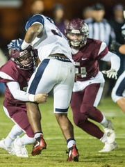 Vermilion Catholic tries to stop the Lafayette Christian Academy running game in the semi-final round of the LHSAA Divisions IV playoffs Friday Nov. 24, 2017.