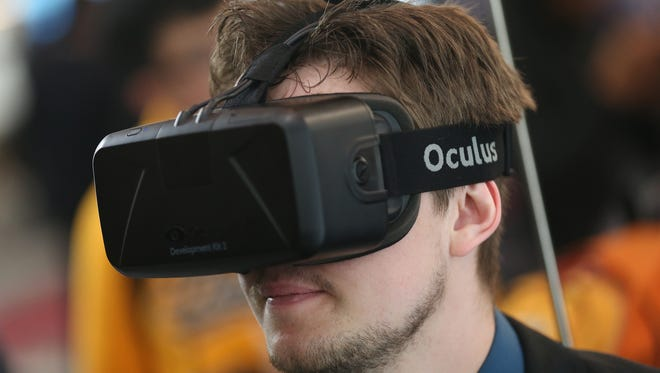 Facebook acquired the virtual-reality start-up Oculus  for $2 billion.