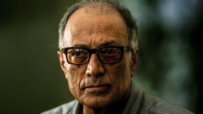 Iranian film director Abbas Kiarostami, seen here in March 2014, has died at 76.