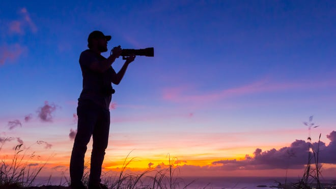 Silhouette of photographer David Zimms taken during a group photo session for sunset silhouettes by the Guam Camera Club.