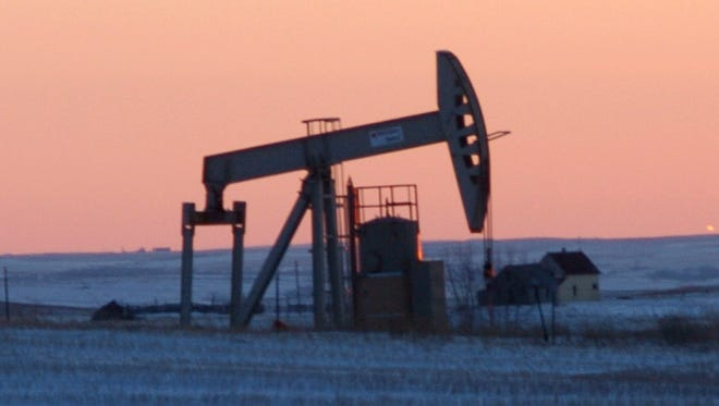 This Feb. 25, 2015, photo, shows a pump jack for pulling oil from the ground, near New Town, N.D. On Tuesday, Nov. 8, 2016, the Energy Department said it is raising its forecast of U.S. production for both 2016 and 2017, as drillers respond to higher crude prices. Still, output won't match 2015, which was the biggest year for U.S. production in 35 years.