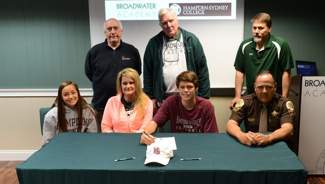 Broadwater Academy's Austin Murphy, bottom row second from right, poses with family and Broadwater faculty as he signs his letter of intent to play football at Hampden-Sydney College this fall. Also pictured, bottom row from left, Murphy's sister Parker, Murphy's mother Melissa, Murphy and Murphy's father Billy; top row from left, Headmaster Joe Spagnolo, Head football coach Noble Palmer and Athletic Director Ron Anson.