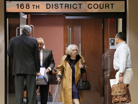 Lisbeth Garrett leaves the 168th District Court on