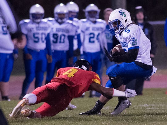 Glasgow safety Reggie Grinnell (4) lunges to bring down St. Georges' Brian Benson during last year's regular-season finale.