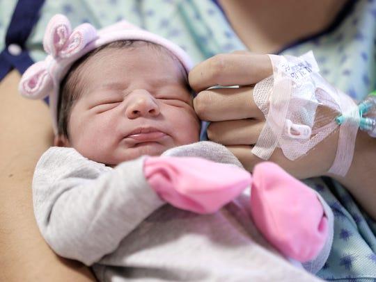 Nora Ramirez carresses her newborn daughter Ailyne