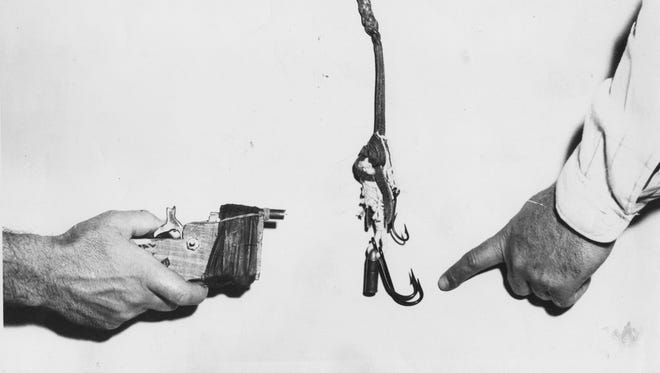 """This photo of gang weapons from June 21, 1950, shows a whip with fish hooks attached, right, and a side view of a """"zip gun."""""""