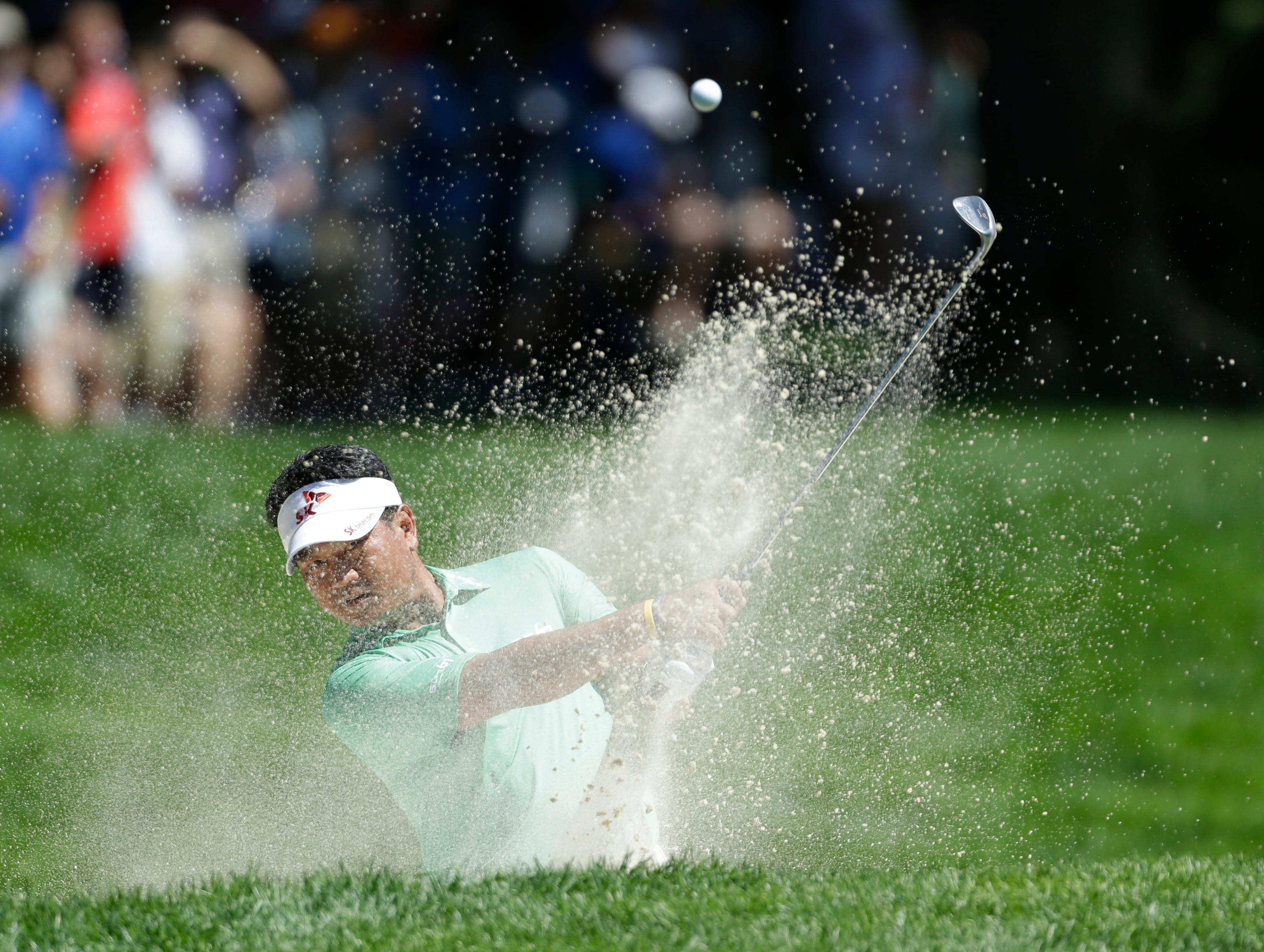 K.J. Choi of South Korea hits out of a bunker on the ninth hole.