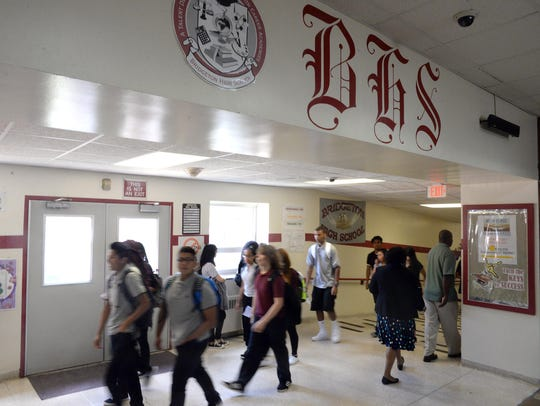 High school students change classes in the hallway