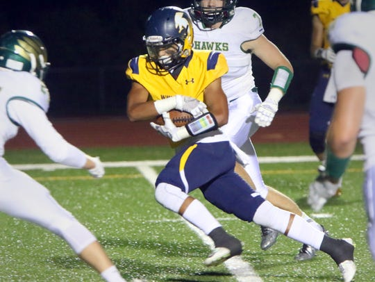 Whitnall's Stephan Flores breaks free for a gain at