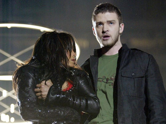 Singers Janet Jackson and surprise guest Justin Timberlake perform during the halftime show at Super Bowl XXXVIII on Feb. 1, 2004, in Houston. At the end of the performance, Timberlake tore away a piece of Jackson's outfit.