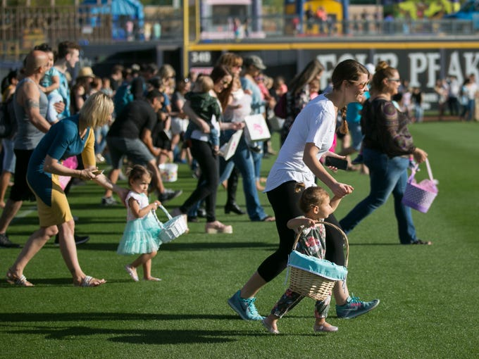 Families run to pick up candy at the 42nd annual Dolly