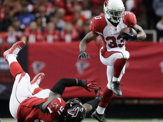Arizona Cardinals running back David Johnson (31) runs past Atlanta Falcons defensive end Courtney Upshaw (91) during the first of an NFL football game, Sunday, Nov. 27, 2016, in Atlanta. (AP Photo/David Goldman)