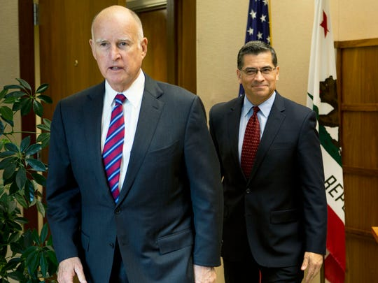 Gov. Jerry Brown with his appointee for state attorney general, Xavier Becerra.