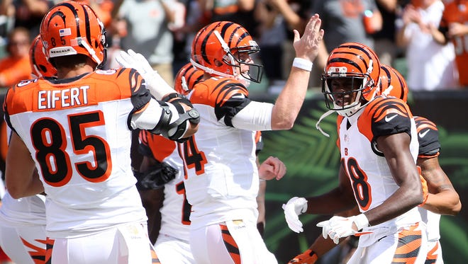 Bengals quarterback Andy Dalton congratulates wide receiver A.J. Green (right) after he scored a touchdown in the first quarter.