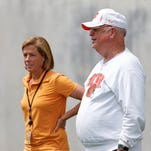 Cincinnati Bengals president, Mike Brown, right, and Katie Blackburn, executive vice president, chat during mini-camp held at Paul Brown Stadium Tuesday June 10, 2014.